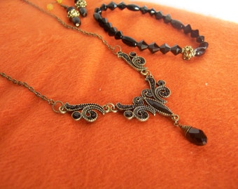 This Delicate Necklace is Antique-looking with Black Beads