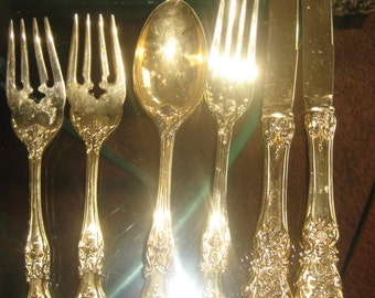 6 pieces of FB Rogers Gold plated flatware
