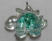 Green Resin Dinosaur Pendant Stegosaurus Seed Beads and Glitter