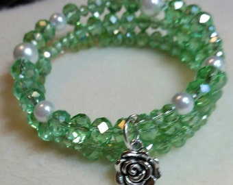 Green glass stone with rose charm