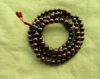Buddhist prayer beads. Buddhist mala. Japa mala. Rosary. Natural garnet with separate beads.