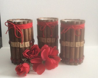 Rustic playful vase/candelholder made with recycled toys .Lincoln logs add  a richness .
