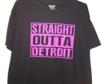 Straight out of Detroit Neon Purple logo on Black T/Shirt all sizes.