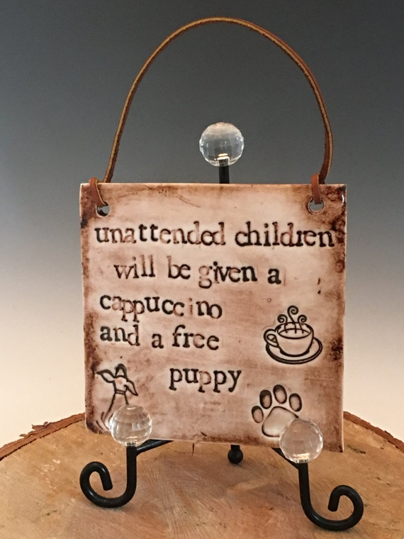 """Clever shop plaque  """"Children left unattended with be given a cappuccino and a free puppy"""""""