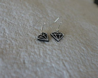 Earring with diamond shaped pendant