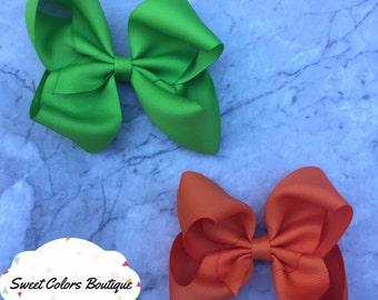 Set Of 2 Orange & Green Hair Bows