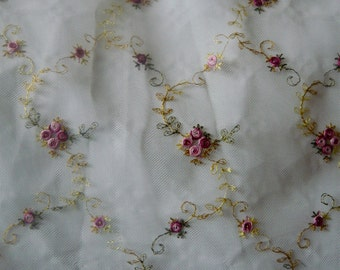tulle lace embroidered with small roses