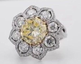 Ring white gold with diamond central fenci yelow 1.01 CT colorizada