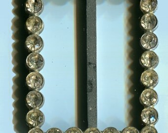 Vintage rectangular buckle with rhinestones.  Never used.