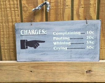 Charges for complaining, pouting, whining & crying distressed sign