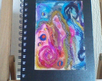 An A5 sketchpad with needlefelt cover