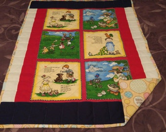 "Nursery rhyme quilt 36""L x 28""W with flannel backing"