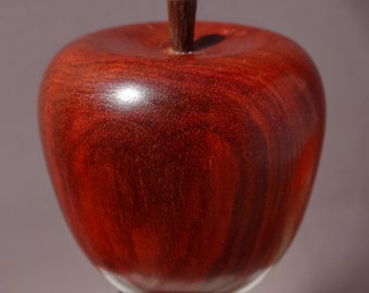 Apple bottle stopper, made of redheart and walnut.