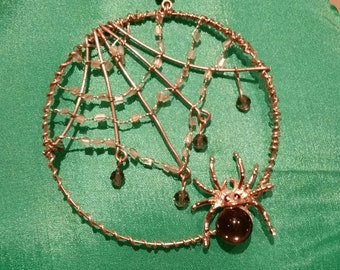 Spider web beaded pendant