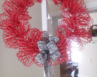 Beautiful Red Mesh Wreath with Black and White Bow.