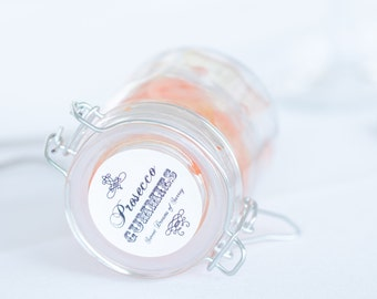 Five elegant glass jars filled with luxurious Prosecco flavoured gummies