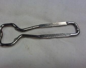 Vintage metal bottle opener