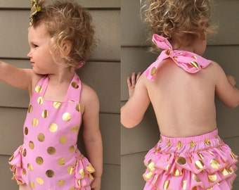Pink romper with gold polkadots and sparkle bow