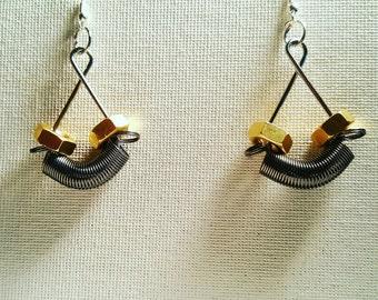 DareByKionde #SpikedAndScrewed collection earrings