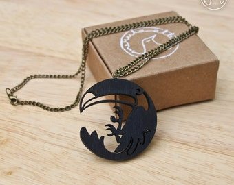 Toucan necklace - round circular lasercut wood pendant - brass chain - black painted
