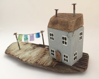 Small driftwood seaside cottage