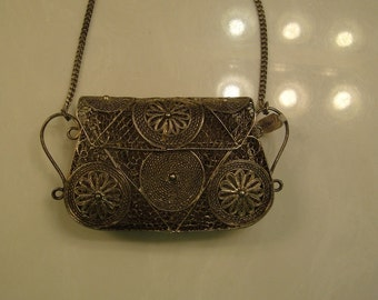 Metal Clutch Purse with a floral design, vintage