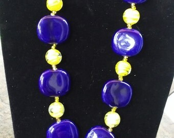 Blue and gold glass bead necklace