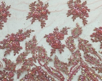 15% off when you buy the Fancy coral, floral, beaded lace, with scallop, edge on both sides, sold by the yard