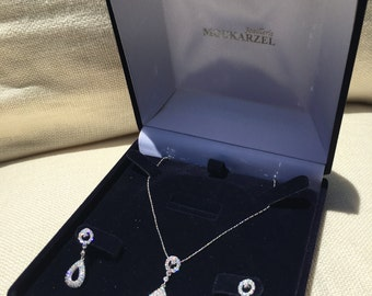White gold diamond earring and pendant set with pave diamonds