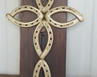 gold cross on stained barn wood