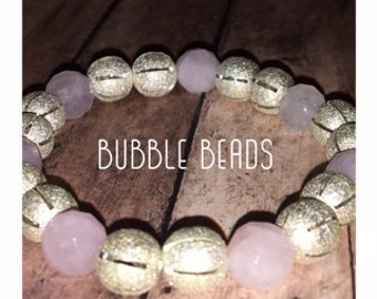 Delicate pink and gold beaded bracelet