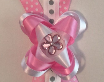 Pink, white and gray bow with a jewel in the center