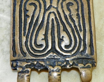 Ancient Tibetan Thogchag Bronze Plaque with bilateral frontal swirls; on back remains of 4 attachment elements 12th - 15th