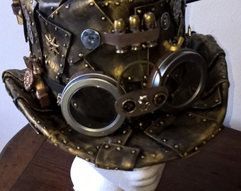 Gold plated Handmade steampunk/burning man top hat with goggles, fake bullets, lots of gears and much more.