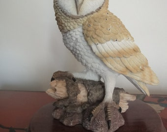 "Tawny Owl perched on a log from the ""leonardo collection"" on wooden plinth   8 inches"