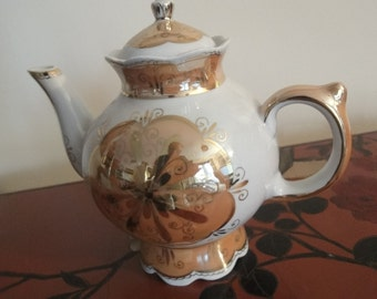 middle size TEA POT in cream with gold inlay from top to bottom really lovely