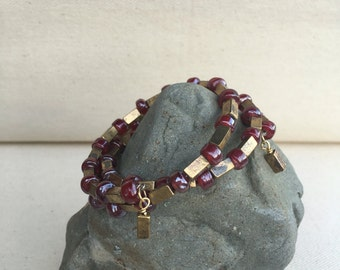 Spiral wrap rust and gold bead bracelet