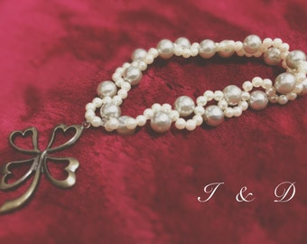 Pearl Bracelet with clover charm