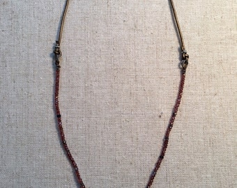 Precious,ruby,semi-precious garnet & amethyst w/sterling cross pend.sterling fittings/lobster clasp.strng on brown silk,bronze   Leather.