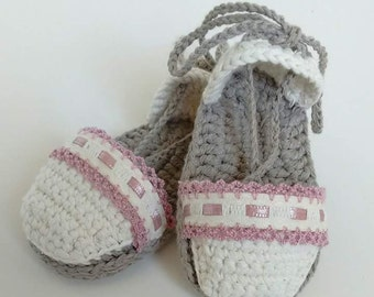 Espadrilles decorated in crochet. Booties made of crochet for baby