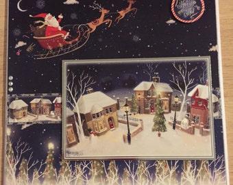 Santa in a sleigh christmas card