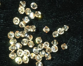 One Dozen (12 pieces) Swarovksi 4mm Crystal Bicones, Crysyal Golden Shadow