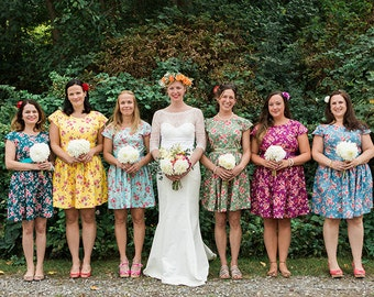Floral bridesmaids dresses mismatched coordinating tea dress cap sleeve vintage style floral print summer wedding colourful bright