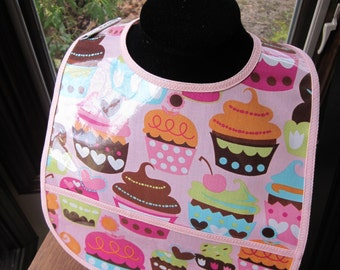 WATERPROOF BIB Wipeable Plastic Coated Baby to Toddler Bib Pink Cupcakes