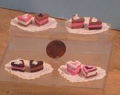 Miniature Valentine pastries set of two on paper doily