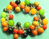 Reserved for montanam 77 - Unique ONE-OF-A-KIND charm bracelet with 37 multicolor genuine tested vintage 1940s bakelite charms