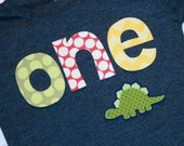 Boys ONE Shirt for 1st Birthday - short sleeve heather navy blue, letters in red yellow green.  Dinosaur party