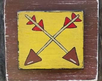 Arrow folk art on wood