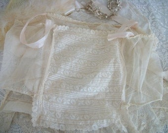antique lace netting bodice chemise camisole, pale pink silk-satin ribbon straps, sweet tattered antique charm