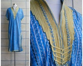70s-80s ethnic caftan in blue. Midi length, lavishly trimmed, glam tunic, blue with silver metallic, size M-L.